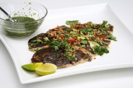 GRILLED MARINATED PENANG FISH WITH CHILLI, GARLIC AND GINGER.   SERVED WITH LEMONGRASS AND BLACK PEPPER DRESSING